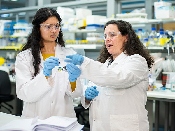 Dr Gabriela Brumatti (right) has made a discovery about cancer drugs that will help to identify the patients who will best respond to treatment